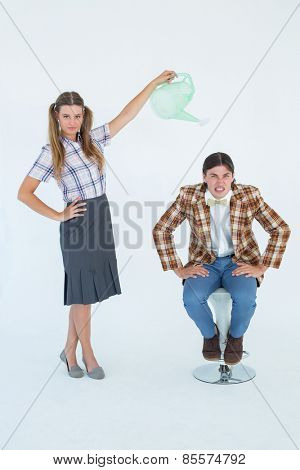 Geeky hipster watering her boyfriend on white background