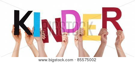 People Holding Colorful Word Kinder Means Kids