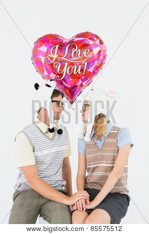 Geeky hipster couple looking to each other on white background