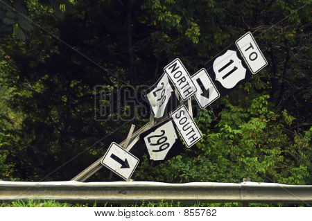 Broken road sign