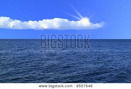 Blue Sky With White Clouds, Sun And Sea