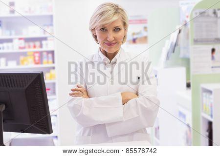 Pharmacist smiling at camera at pharmacy