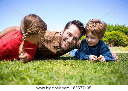 Happy father with his children in the countryside