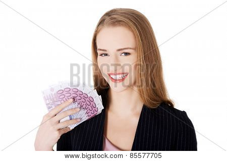 Businesswoman holding a clip of dollars.