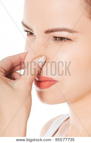 Portrait of a woman clogging nose.