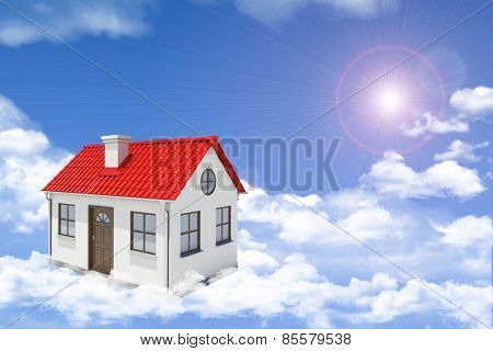 White house with red gable roof and chimney floating in clouds. Background sun shines brightly