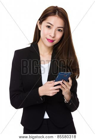 Young businesswoman with smartphone