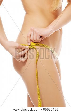 Close up on woman measuring her hips.
