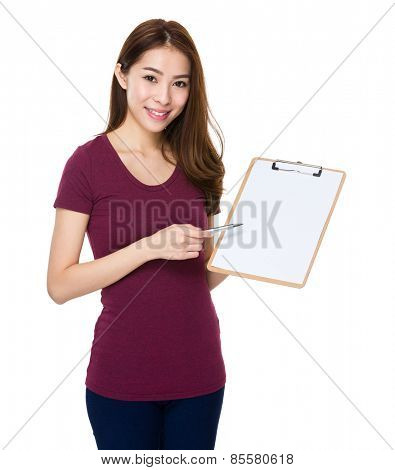 Young cheerful woman with pen and clipboard