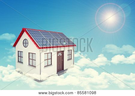 White house with red roof, solar panels in cloud. Background sun shines brightly