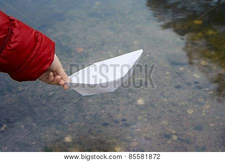 Girl Let A Paper Boat On The River Closeup