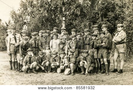 SZCZAWNICA, POLAND, CIRCA 1950's: Vintage photo of group of scouts and their tutors outdoor