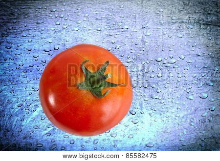 Red Tomato over blue Water drops background grunge style