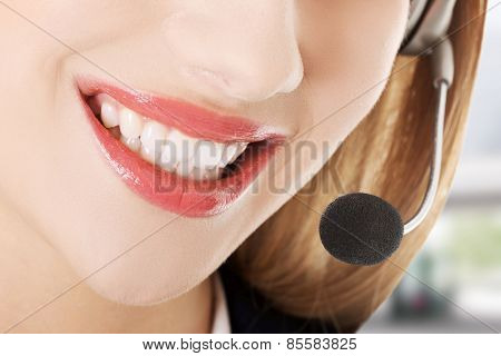 Young call centre assistant smiling