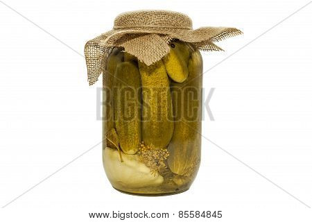 Pickled cucumbers in a glass jar isolated on white