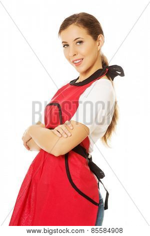 Happy young woman wearing apron