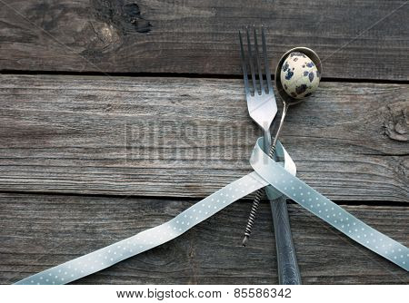 Quail Egg In A Spoon On A Wooden Table