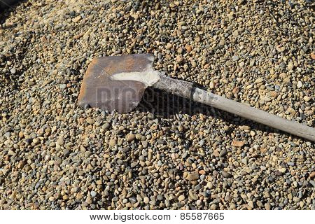 Shovel On Crushed Stone