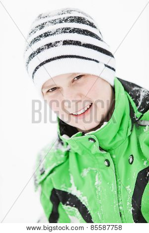 Happy Young Boy Sprinkled With Winter Snow