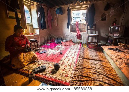 BHAKTAPUR, NEPAL - CIRCA DEC, 2013: Unidentified poor people in a house. The caste system is still intact today but the rules are not as rigid as they were in the past.