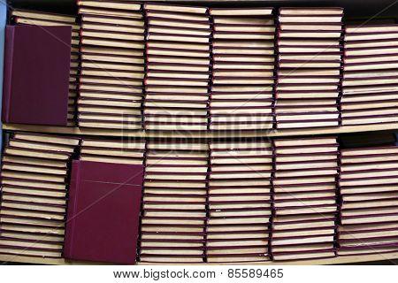 Many books on bookshelf in library