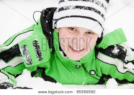 Cute Young Boy With A Happy Smile In Winter Snow