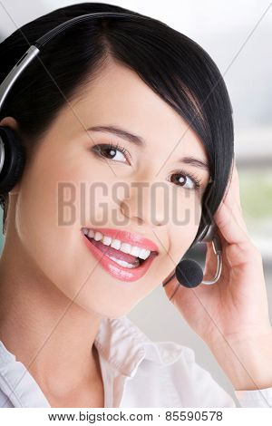 Beautiful young call-center assistant smiling.