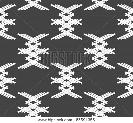 Monochrome Pattern With White Crossed Shapes On Gray
