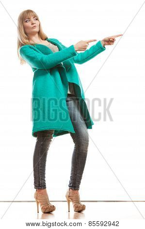 Woman In Green Coat Showing Copy Space