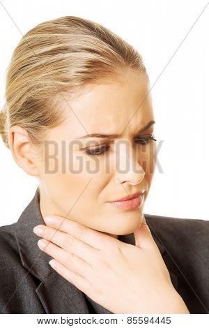 Woman having huge throat pain