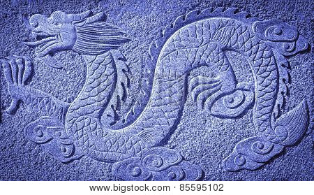 Chinese blue dragon carved in the stone