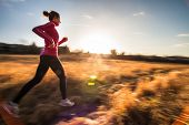 pic of fall day  - Young woman running outdoors on a lovely sunny winter - JPG