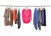 picture of racks  - Female Variety of colorful clothes hanging on the rack - JPG