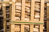 foto of pallet  - Solid biofuel as fire wood made of birch stacked on pallets in outdoor stock - JPG