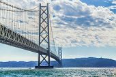 stock photo of guinness  - The bridge has the longest central span of any suspension bridge in the world - JPG