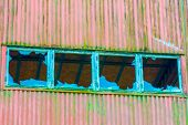 picture of roof-light  - Four broken windows in a row on old industrial building - JPG