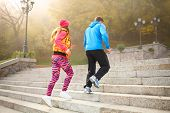 picture of upstairs  - Young couple of athlets running upstairs in the morning viewed from behind - JPG