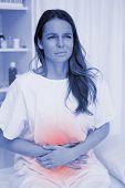 foto of belly ache  - Woman having terrible belly ache - JPG