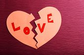 picture of broken hearted  - Broken heart on colour background - JPG