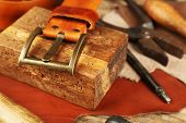 stock photo of leather tool  - Leather and craft tools on table close up - JPG