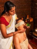 foto of ayurveda  - Woman having nose ayurveda spa treatment - JPG