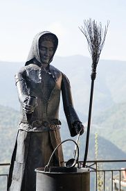pic of metal sculpture  - sculpture of a witch made of dark metal - JPG