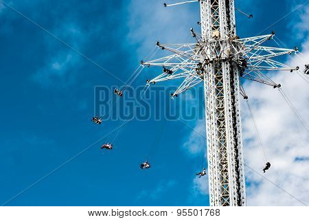 Carousel In The Air Towards A Blue Sky With Clouds