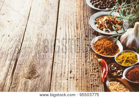 Colorful spices and on a wooden background