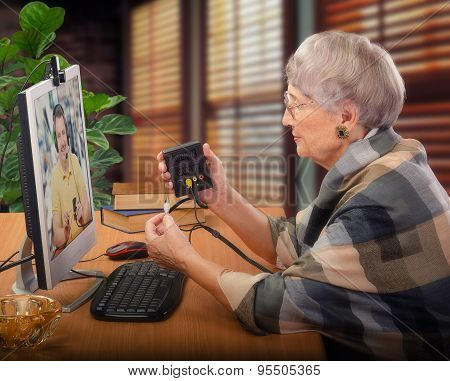 Senior woman taking computer course
