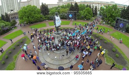 RUSSIA, MOSCOW - MAY 17, 2014: Students put stickers on monument of Lomonosov on MGU square during Day of Physicist. Aerial view