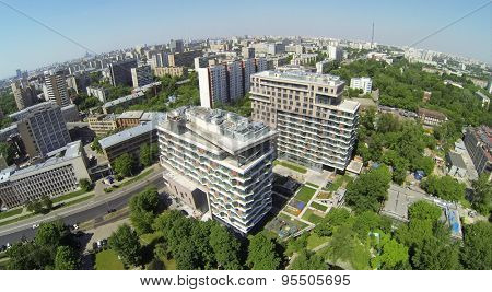 RUSSIA, MOSCOW - MAY 20, 2014: Townscape with dwelling complex Barkli Park at spring sunny day. Aerial view.