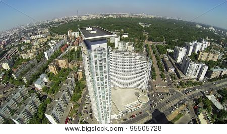 RUSSIA, MOSCOW - MAY 20, 2014: Dwelling complex against cityscape with large park at spring sunny day. Aerial view