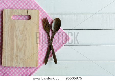Wooden Spoon And Fork On White Wooden Table