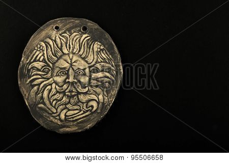Ceramic Male Gorgon Medusa Head In Bath Isolated On Black